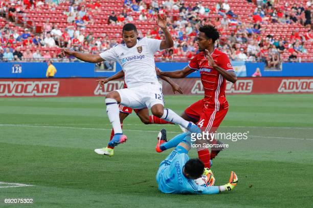 Real Salt Lake midfielder Omar Holness leaps over a save by FC Dallas goalkeeper Jesse Gonzalez during the MLS match between Real Salt Lake and FC...