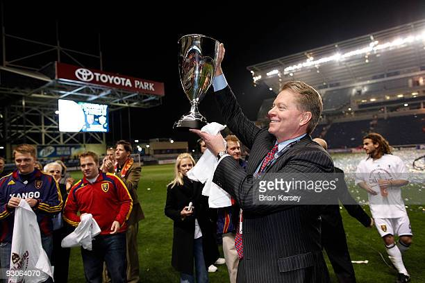 Real Salt Lake owner Dave Checketts hoists the Eastern Conference trophy after his team defeated the Chicago Fire in the MLS Eastern Conference...