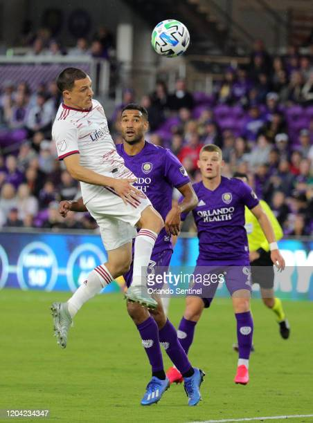 Real Salt Lake's Donny Toia left takes a header during against Orlando City at Exploria Stadium in Orlando Fla on Saturday February 29 2020 The game...