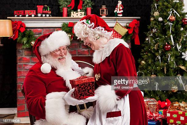 Real Santa and Mrs. Claus Giving Gifts to Each Other