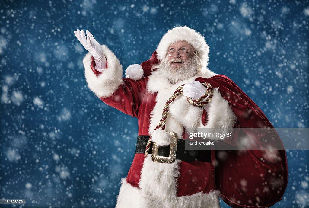 Real Santa Catching Snowflakes : Stock Photo