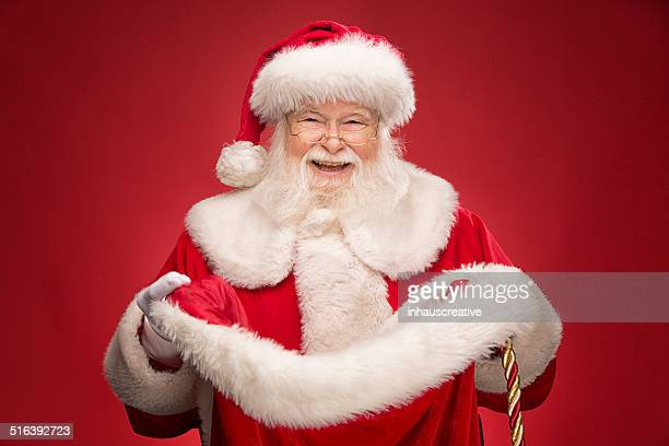 Real Santa Claus opening gift bag