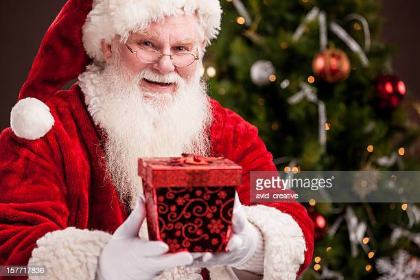 Real Santa Giving Gift
