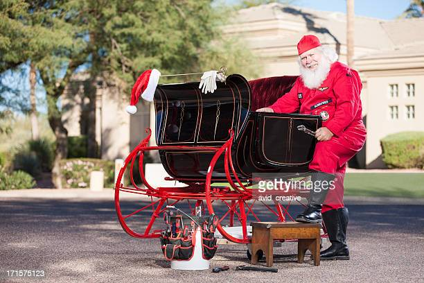 Real Santa Mechanic Working on Sleigh