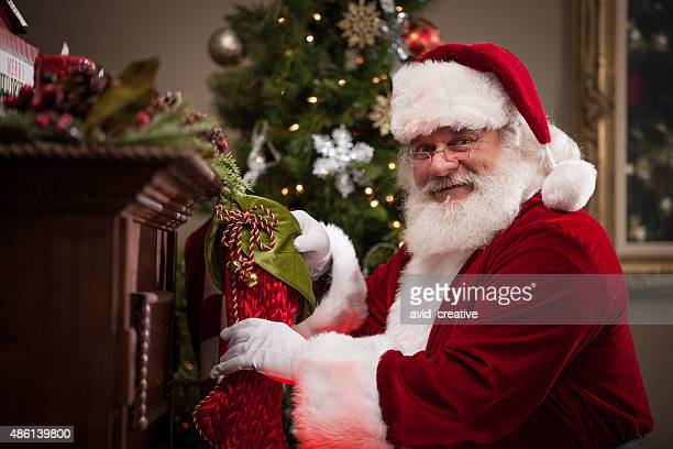 Real Santa Putting Goodies in Stockings