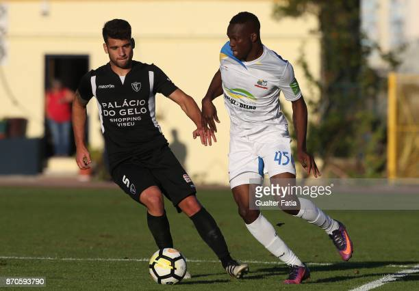 Real SC forward Abdoulaye Diallo from Senegal with AC Viseu defender Kiko in action during the Segunda Liga match between Real SC and AC Viseu at...