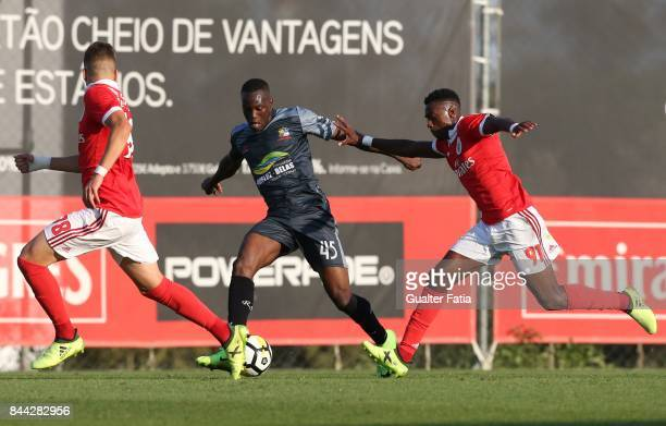 Real SC forward Abdoulaye Diallo from Senegal with SL Benfica forward Heriberto Tavares from Portugal in action during the Segunda Liga match between...