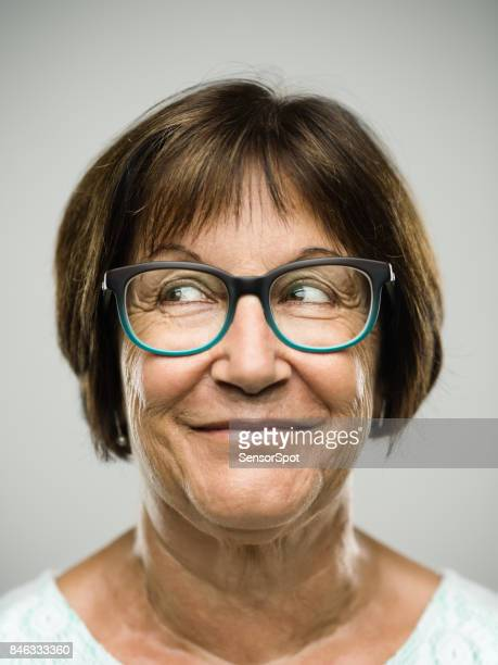 real senior woman portrait looking away - smirking stock pictures, royalty-free photos & images