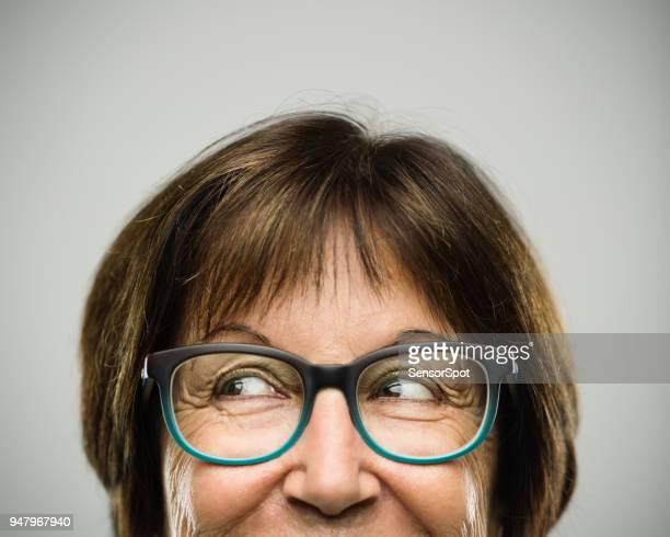 Real senior woman portrait looking away