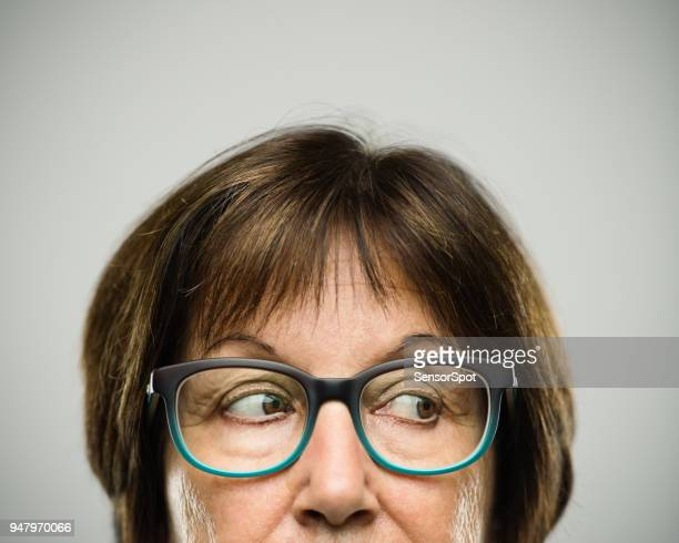 real senior woman portrait looking to the side - sideways glance stock pictures, royalty-free photos & images