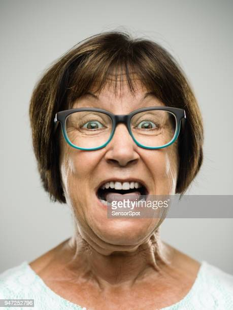 real shouting senior woman portrait - female torture stock pictures, royalty-free photos & images