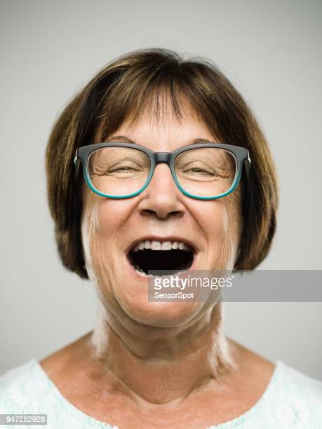 real shouting senior woman portrait - mouth open stock pictures, royalty-free photos & images