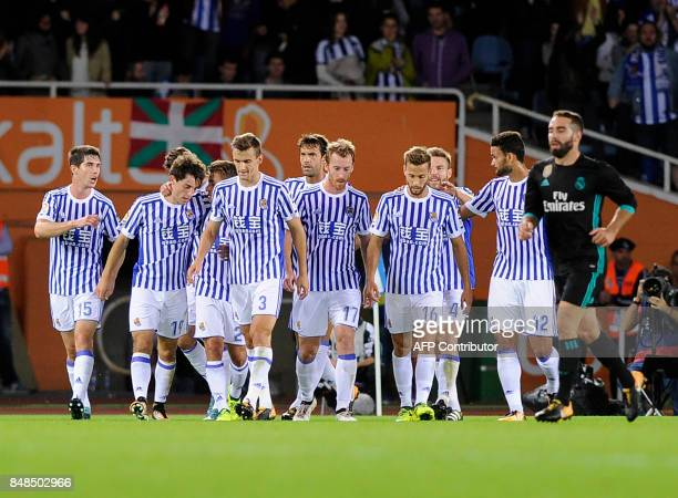 Real Sociedad players celebrate their first goal during the Spanish league football match Real Sociedad vs Real Madrid CF at the Anoeta stadium in...