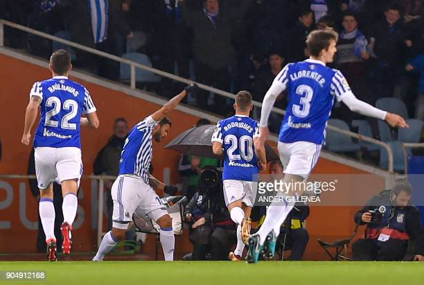 Real Sociedad players celebrate their opening goal by Brazilian forward Willian Jose during the Spanish league football match between Real Sociedad...
