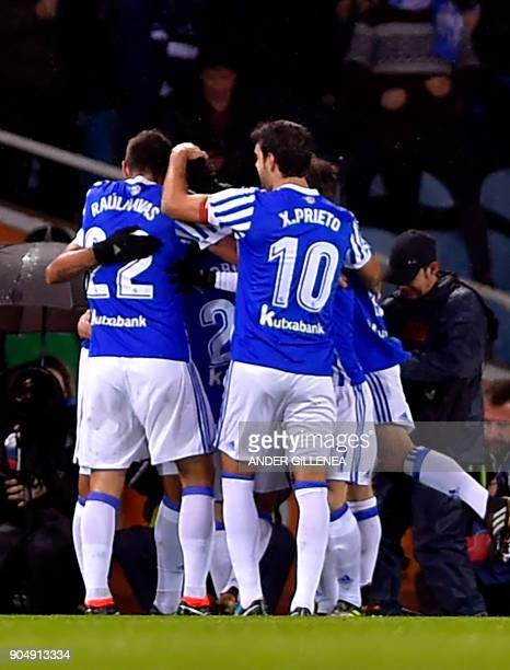 Real Sociedad players celebrate their opening goal during the Spanish league football match between Real Sociedad and FC Barcelona at the Anoeta...