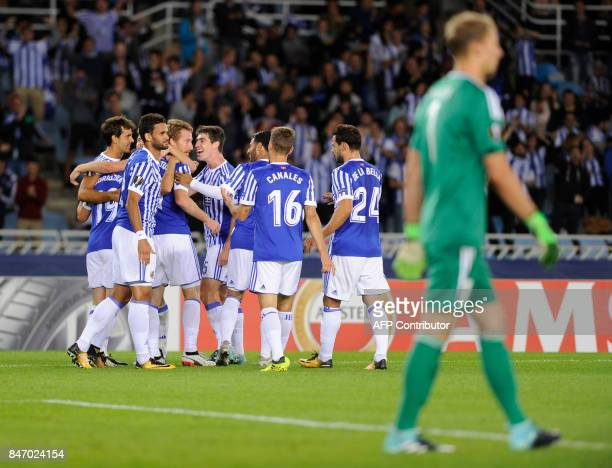 Real Sociedad players celebrate their second goal during the Europa League football match Real Sociedad vs Rosenborg BK at the Anoeta stadium in San...