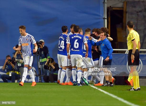 Real Sociedad players celebrate their second goal during the Spanish league football between Real Sociedad and Club Atletico de Madrid at the Anoeta...