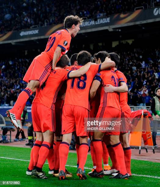 Real Sociedad players celebrate their second goal during the UEFA Europa League first leg round of 32 football match between Real Sociedad and FC...