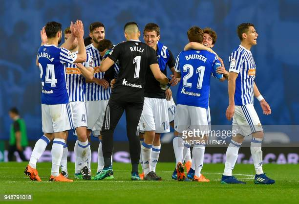 Real Sociedad players celebrate their win at the end of the Spanish league football between Real Sociedad and Club Atletico de Madrid at the Anoeta...