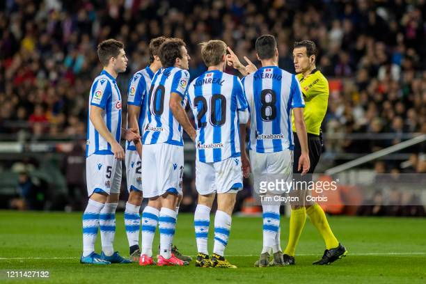 March 7: Real Sociedad players complain to referee Juan Martínez Munuera after a VAR decision awarded a penalty kick to Barcelona during the...