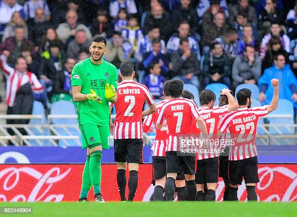 Real Sociedad's Argentinian goalkeeper Geronimo Rulli gestures after Athletic scoring the secong goal during the Spanish league football match Real...