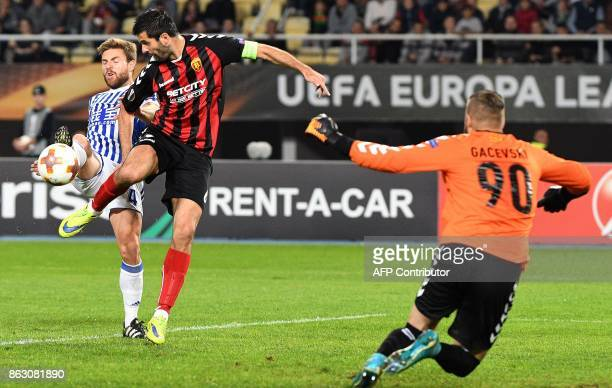 Real Sociedad's Aser Illarramendi vies with Vardar's Boban Grncarov during the UEFA Europa League Group L football match between FK Vardar and Real...