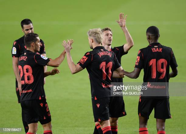 Real Sociedad's Belgian forward Adnan Januzaj celebrates after scoring a goal during the Spanish League football match between Real Betis and Real...