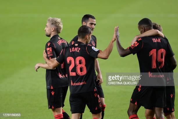 Real Sociedad's Belgian forward Adnan Januzaj celebrates with teammates after scoring a goal during the Spanish League football match between Real...