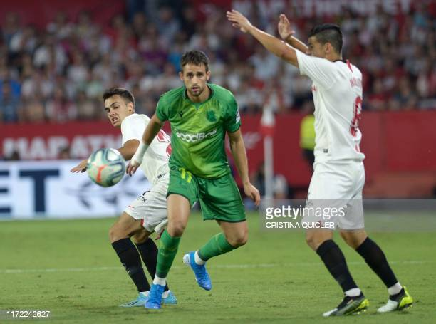 Real Sociedad's Belgian forward Adnan Januzaj vies for the ball with Sevilla's Spanish defender Sergi Gomez during the Spanish league football match...