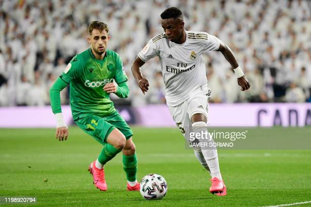 Real Sociedad's Belgian forward Adnan Januzaj vies with Real Madrid's Brazilian forward Vinicius Junior during the Spanish Copa del Rey quarterfinal...