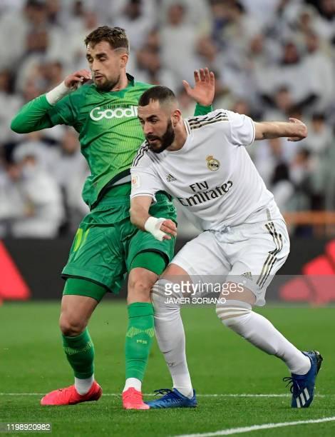 Real Sociedad's Belgian forward Adnan Januzaj vies with Real Madrid's French forward Karim Benzema during the Spanish Copa del Rey quarterfinal...