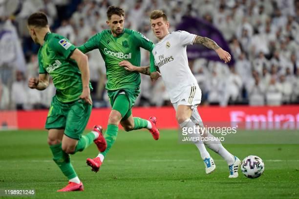 Real Sociedad's Belgian forward Adnan Januzaj vies with Real Madrid's German midfielder Toni Kroos during the Spanish Copa del Rey quarterfinal...