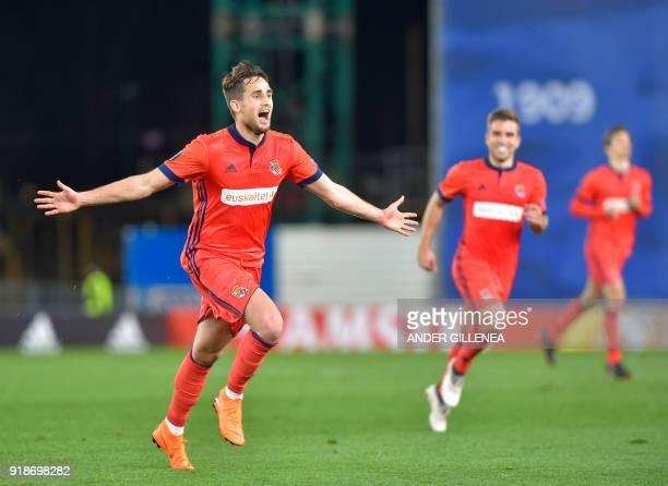 Real Sociedad's Belgian midfielder Adnan Januzaj celebrates after scoring his team's second goal during the UEFA Europa League first leg round of 32...