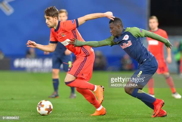 Real Sociedad's Belgian midfielder Adnan Januzaj vies with FC Salzburg's Malian midfielder Diadie Samassekou during the UEFA Europa League first leg...