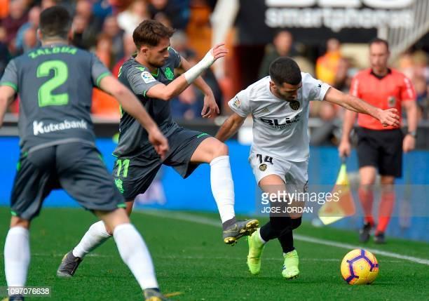 Real Sociedad's Belgian midfielder Adnan Januzaj vies with Valencia's Spanish defender Jose Gaya during the Spanish league football match Valencia CF...