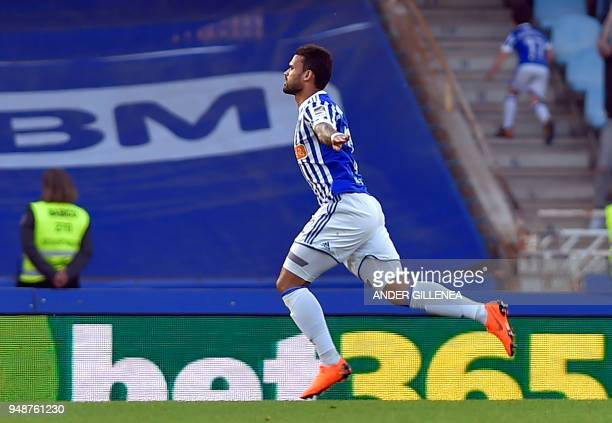 Real Sociedad's Brazilian forward Willian Jose celebrates after scoring his team's first goal during the Spanish league football between Real...