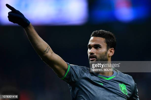 Real Sociedad's Brazilian forward Willian Jose celebrates the opening goal during the Spanish League football match between Real Madrid CF and Real...