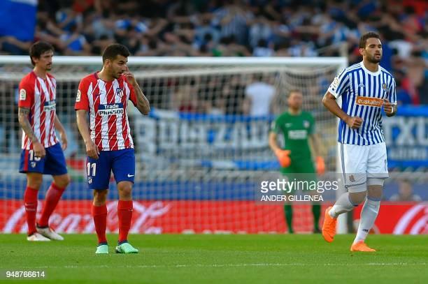 Real Sociedad's Brazilian forward Willian Jose runs past Atletico Madrid's Montenegrin defender Stefan Savic and Atletico Madrid's Argentinian...