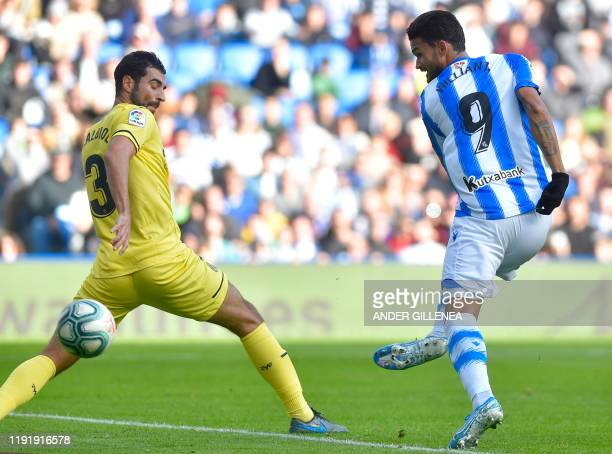 Real Sociedad's Brazilian forward Willian Jose shoots to score a goal during the Spanish league football match between Real Sociedad and Villarreal...