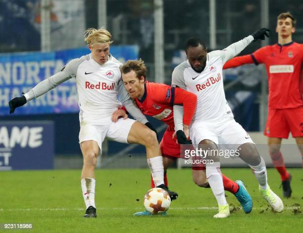 Real Sociedad's David Zurutuza Veillet vies with FC Red Bull Salzburg's Xaver Schlager Reinhold and Ray Yabo during the round of 32 UEFA Europa...