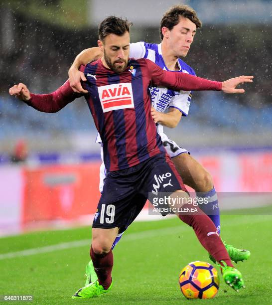 CORRECTION Real Sociedad's defender Alvaro Odriozola vies with Eibar's defender Antonio Luna during the Spanish league football match Real Sociedad...
