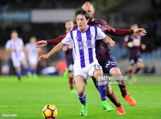 CORRECTION Real Sociedad's defender Alvaro Odriozola vies with Eibar's defender Ivan Ramis during the Spanish league football match Real Sociedad vs...