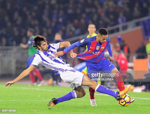 TOPSHOT Real Sociedad's defender Carlos Martinez vies with Barcelona's Brazilian forward Neymar da Silva Santos Junior during the Spanish league...