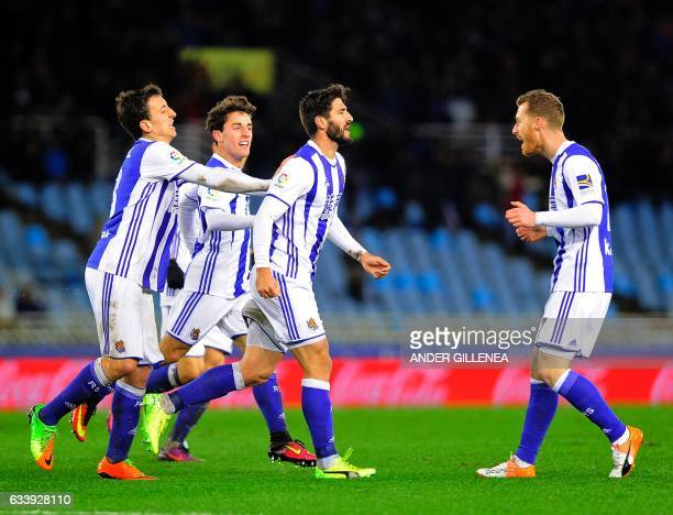 Real Sociedad's defender Raul Navas celebrates with teammates after scoring his team's first goal during the Spanish league football match Real...