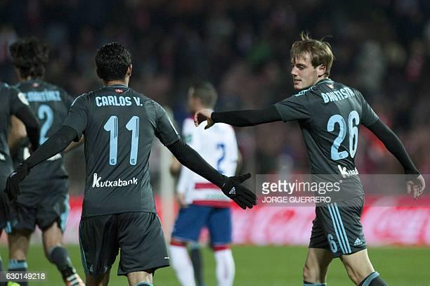 Real Sociedad's forward Jon Bautista celebrates a goal with Real Sociedad's Mexican forward Carlos Vela during the Spanish league football match...