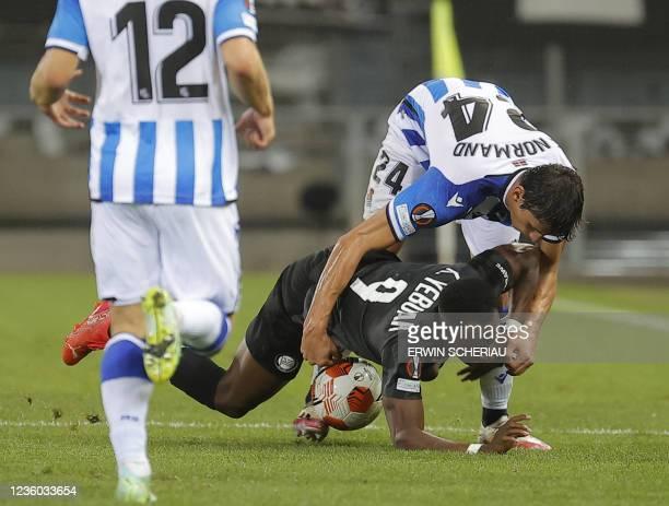 Real Sociedad's France's defender Robin Le Normand and Sturm Graz's Ghanaian forward Kelvin Yeboah vie for the ball during the UEFA Europa League...