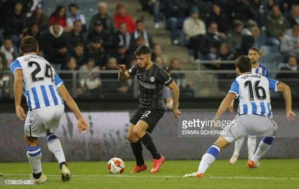 Real Sociedad's France's defender Robin Le Normand, Sturm Graz's Bosnian defender Jusuf Gazibegovic and Real Sociedad's Spanish midfielder Ander...