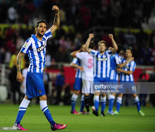 Real Sociedad's French defender Liassine CadamuroBentaiba celebrates at the end of the Spanish league football match Sevilla FC vs Real Sociedad at...