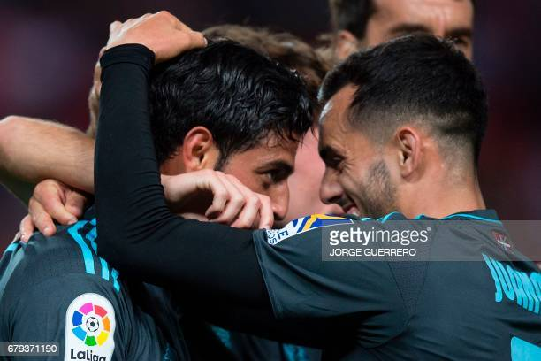 Real Sociedad's Mexican forward Carlos Alberto Vela celebrates with forward Juanmi after scoring during the Spanish league football match Sevilla FC...
