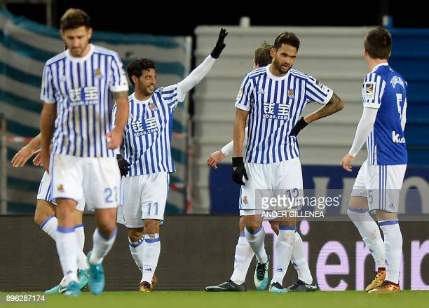 Real Sociedad's Mexican forward Carlos Vela celebrates after scoring his team's third goal during the Spanish league football match Real Sociedad...